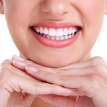 Restorative dentistry has left this woman's smile bright and shiny.